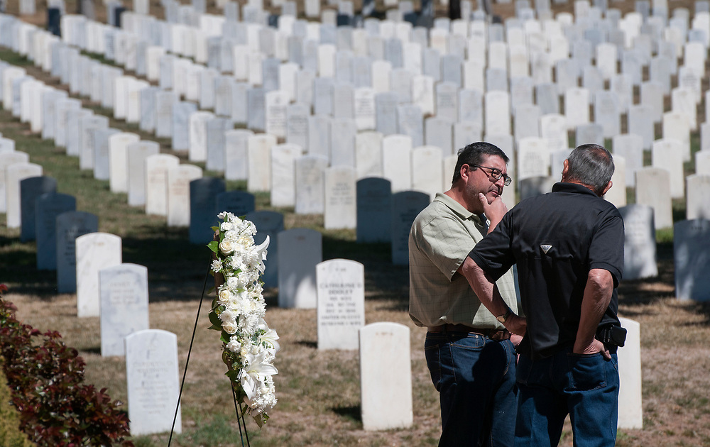 em040617d/jnorth/Juan Chavez, from Santa Fe, left, and Ledis Molina, from Albuquerque, who is retired from the Marines and USAF, talk after a small ceremony to prestent a wreath at the Santa Fe National Cemetery in commemorate the 100th anniversary of the U.S. gating involved in World War I. This was at the Santa Fe National Cemetery Thursday April 6, 2017. (Eddie Moore/Albuquerque Journal