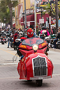 A biker wearing a spider man costume cruises down Main Street during the 74th Annual Daytona Bike Week March 7, 2015 in Daytona Beach, Florida.