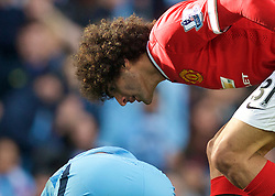 MANCHESTER, ENGLAND - Sunday, November 2, 2014: Manchester United's Marouane Fellaini screams at Manchester City's Sergio Aguero after he went down in the penalty area during the Premier League match at the City of Manchester Stadium. (Pic by David Rawcliffe/Propaganda)