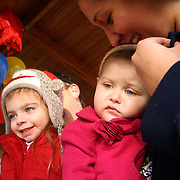 Ella Gardner, 5 and her Father Eric pose for a photo with Holly Larue Frizzelle, 2  and her mother Leilani at Ella's fifth birthday party. Ella chose to dedicate her fifth birthday party to Larue and accept donations in lieu of presents. On December 27, 2012 two year old Holly Larue Frizzelle was diagnosed with Acute Lymphoblastic Leukemia. What began as a stomach ache and visit to her regular pediatrician led to a hospital admission, transport to the University of North Carolina Children's Hospital, and more than two years of treatment.