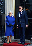 © Licensed to London News Pictures. 18/12/2012. Westminster, UK Queen Elizabeth II meets British Prime Minister David Cameron on the steps of 10 Downing Street prior to observing a cabinet meeting, she is the first monarch to do so since Queen Victoria. Photo credit : Stephen Simpson/LNP