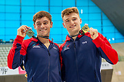 Tom Daley of Great Britain and Matty Lee of Great Britain with their Gold Medals they won in the Men's Syncronised 10m Dive during the FINA/CNSG Diving World Series 2019 at London Aquatics Centre, London, United Kingdom on 17 May 2019.