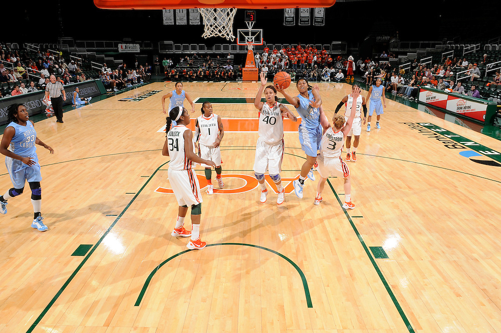 February 8, 2012: Tierra Ruffin-Pratt #44 of North Carolina shoots past Shawnice Wilson #40 and Stefanie Yderstrom #3 of Miami during the NCAA basketball game between the Miami Hurricanes and the North Carolina Tar Heels at the Bank United Center in Coral Gables, FL. The Hurricanes defeated the Tar Heels 61-37.