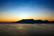 Coastal mountains at sunrise, Procida, Campania, Italy.