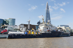 © Licensed to London News Pictures. 12/09/2017. LONDON, UK.  THV Galatea has arrived in London and is moored next to HMS Belfast in front of the Shard for London International Shipping Week. THV Galatea is a Trinity House multi-function ship, designed to carry out marine operations as part of their duty as the General Lighthouse Authority for England, Wales, the Channel Islands and Gibraltar. An estimated 15,000 shipping industry leaders are expected to attend events in London and on board the THV Galatea during International Shipping Week this week. Photo credit: Vickie Flores/LNP
