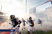 Liberty Flames Football players take to the field on Sept. 5, 2015.