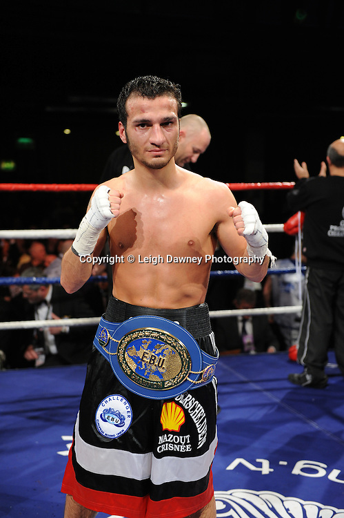 Ermano Fegatilli (pictured with belt) defeats Stephen Foster Jnr claiming the European Super Featherweight Title after 12 x 3min rounds. Venue: Premier Suite,Reebok Stadium, Bolton,UK. Saturday 26th February 2011. Hatton Promotions. Photo credit © Leigh Dawney.