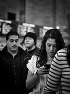 Checking the latest phone message at Grand Central Terminal