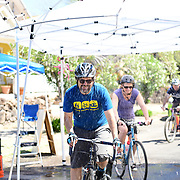 Intrepid bike commuter Jonathan Martin enjoying his ride through the Cyclovia Tucson Rain Tunnel. His wife, Carman Ryken, is following.