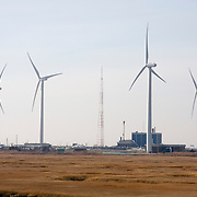 Wind Farm....The Jersey-Atlantic Wind Farm (located in Atlantic City, NJ, USA) is a joint project by Community Energy Inc. (CEI), a subsidiary of Iberdrola, and the Atlantic County Utilities Authority (ACUA). The wind generation facility is sized to meet the electrical load requirements of the ACUA Wastewater Treatment Facility with remaining excess energy being sold to the regional power grid. The wind farm consists of five 1.5-megawatt wind turbines manufactured by General Electric. The towers are approximately 262 feet high with three rotors of 118 feet for a total height of about 380 feet.