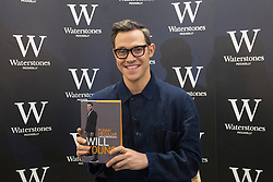 © licensed to London News Pictures. London, UK 26/10/2012. Singer-songwriter and actor Will Young posing with his autobiography, Funny Peculiar (published October 11) at Waterstones, Piccadilly in London. Photo credit: Tolga Akmen/LNP