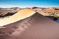 Man walking in Dunes, Sossusvlei, Namibia