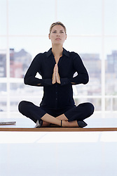 Dec. 05, 2012 - Woman meditating on her desk (Credit Image: © Image Source/ZUMAPRESS.com)