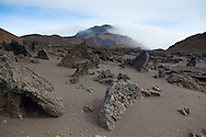 This trail is through many of the Pu'u, or Cinder Cones, which cover Haleakala's interior.  Pictured here are remnants of a lava flow and Hanakauhi is visible in the distance.