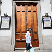 MILAN, ITALY - JUNE 07:  A woman walks past the Auction Room of Italian institutional pawnbrokers in Via Monte di Pieta' on June 7, 2010 in Milan, Italy. Today the Italian stock market suffered new losses in particular the banking sector and the Euro falls below $1.19, the lowest in over 4 years  (Photo by Marco Secchi/Getty Images)