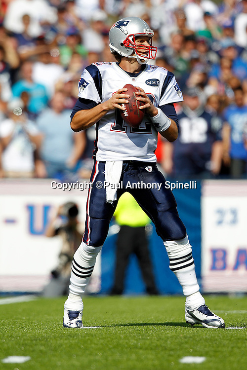 New England Patriots quarterback Tom Brady (12) drops back to pass during the NFL week 3 football game against the Buffalo Bills on Sunday, September 25, 2011 in Orchard Park, New York. The Bills won the game 34-31. ©Paul Anthony Spinelli