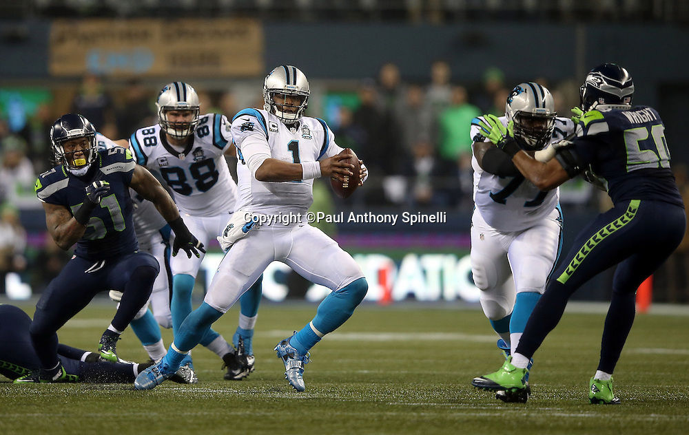Carolina Panthers quarterback Cam Newton (1) is forced to run as he scrambles away from pressure by Seattle Seahawks outside linebacker Bruce Irvin (51) on a second quarter play during the NFL week 19 NFC Divisional Playoff football game against the Seattle Seahawks on Saturday, Jan. 10, 2015 in Seattle. The Seahawks won the game 31-17. ©Paul Anthony Spinelli