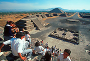 MEXICO, TEOTIHUACAN students on Pyramid of Moon stairway