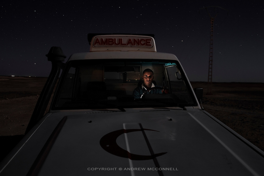 Mohamed Lamin Slot, 26, ambulance driver, pictured in the desert near Rabouni refugee camp, Algeria...I was born in El Aaiun camp in 1983. I grew up here, we got accustomed to it. I studied in Algeria for six years. I started working as an ambulance driver in 2005, it is a great job and I like it. There is a lot of tiredness but I like to help people. It took one year to train in first aid, it was very difficult at first, you remember many bad things like blood and injuries but now it's normal for me. We never rest there are always emergencies, maybe there are eight or nine cases per day. I work from Saturday to Friday and work the whole week even sleeping in the hospital, then I have the following week off. I get almost no sleep during that week. The hardest thing is when people die on the way to the hospital, you wish you could have got them there but you couldn't. ..Over time I know the best routes between the camps, it is sometimes difficult at night. I once got lost in the sand storm with a patient, we were very afraid. I was carrying an old man to Auserd [refugee camp], the storm came after sunset so we could not see anything, I was careful and found the tracks, eventually and we got there in the end. To drive here you must know the tracks, it takes practise, different tracks go to different camps so you have to know the right one. There is one road built by the Algerians but it only goes from Rabouni to Twenty Seven [of February refugee camp] and Smara [refugee camp], it is a big help for us. Dakhla [refugee camp] is the worst place to have an emergency, it is very far, there is a road but it doesn't reach it. There is one ambulance per camp with two drivers. Its not enough...We expect a lot and wish for many things but there is nothing. We haven't seen tangible results. Peace is very nice but it's better to back to war... although perhaps then I would have hundreds of cases to take [to hospital]. No one wants to die but it's too long to wait. We are born her