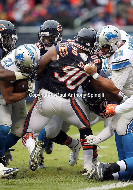 Chicago Bears defensive lineman Greg Scruggs (90) has the neck of his jersey pulled from behind by Detroit Lions guard Manny Ramirez (63) as he attempts to tackle Detroit Lions rookie running back Ameer Abdullah (21) during the NFL week 17 regular season football game against the Detroit Lions on Sunday, Jan. 3, 2016 in Chicago. The Lions won the game 24-20. (©Paul Anthony Spinelli)