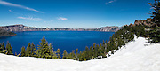 The waters of Crater lake look really ink blue.  A massive volcanic eruption that happend  about 7700 years ago converted a mountain peak into the  Crater Lake.  The ink blue color is the only color not absorbed by the  ultra deep transparent  water. It  is the deepest lake in the USA. Crater Lake National Park, Oregon.