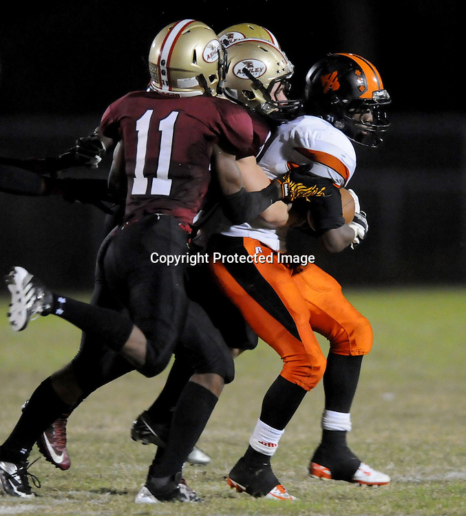 New Hanover High School's Ramone Simpson rushes against Ashley's Obrien Hutchinson, foreground, Bruce Kopka, center, and Daniel Barrett. (Jason A. Frizzelle)