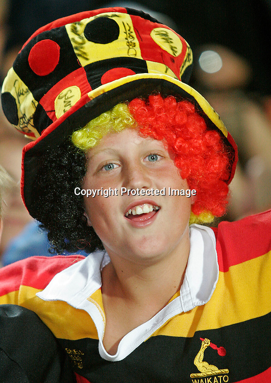 A young Chiefs fan enjoys his time at the Super 14 rugby union match between the Chiefs and the Crusaders at Waikato Stadium, Hamilton on Friday 10 March 2006. The Crusaders won the game 25-19. Photo: Andy Song/PHOTOSPORT