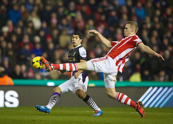STOKE-ON-TRENT, ENGLAND - Sunday, January 12, 2014: Liverpool's Luis Suarez scores the second goal against Stoke City during the Premiership match at the Britannia Stadium. (Pic by David Rawcliffe/Propaganda)