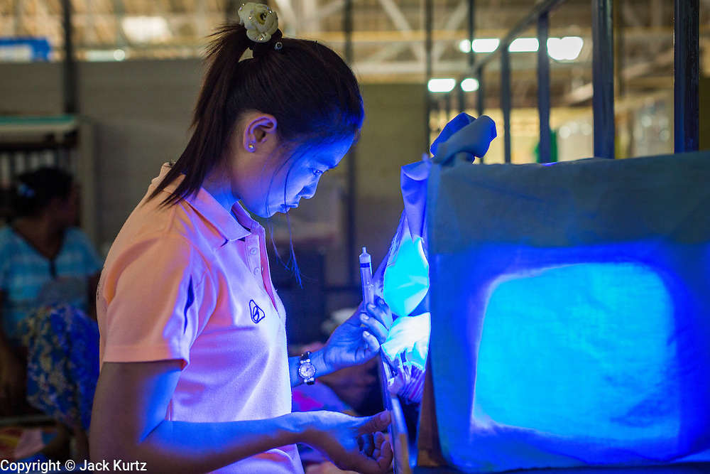 20 MAY 2013 - MAE KASA, TAK, THAILAND:  A Burmese health care worker tends to a baby in an incubator at the SMRU clinic in Mae Kasa, Thailand. Babies are at high risk for being infected with malaria because their immune systems can't fight off the parasite. Health professionals are seeing increasing evidence of malaria resistant to artemisinin coming out of the jungles of Southeast Asia. Artemisinin has been the first choice for battling malaria in Southeast Asia for 20 years. In recent years though,  health care workers in Cambodia and Myanmar (Burma) are seeing signs that the malaria parasite is becoming resistant to artemisinin. Scientists who study malaria are concerned that history could repeat itself because chloroquine, an effective malaria treatment until the 1990s, first lost its effectiveness in Cambodia and Burma before spreading to Africa, which led to a spike in deaths there. Doctors at the Shaklo Malaria Research Unit (SMRU), which studies malaria along the Thai Burma border, are worried that artemisinin resistance is growing at a rapid pace. Dr. Aung Pyae Phyo, a Burmese physician at a SMRU clinic just a few meters from the Burmese border, said that in 2009, 90 percent of patients were cured with artemisinin, but in 2010, it dropped to about 70 percent and is now between 55 and 60 percent. He said the concern is that as it becomes more difficult to clear the parasite from a patient, progress that has been made in combating malaria will be lost and the disease could make a comeback in Southeast Asia.    PHOTO BY JACK KURTZ