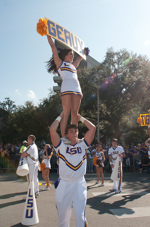 LSU Tigers cheerleaders cheering the crowd before the Mississippi Rebels and LSU Tigers game.