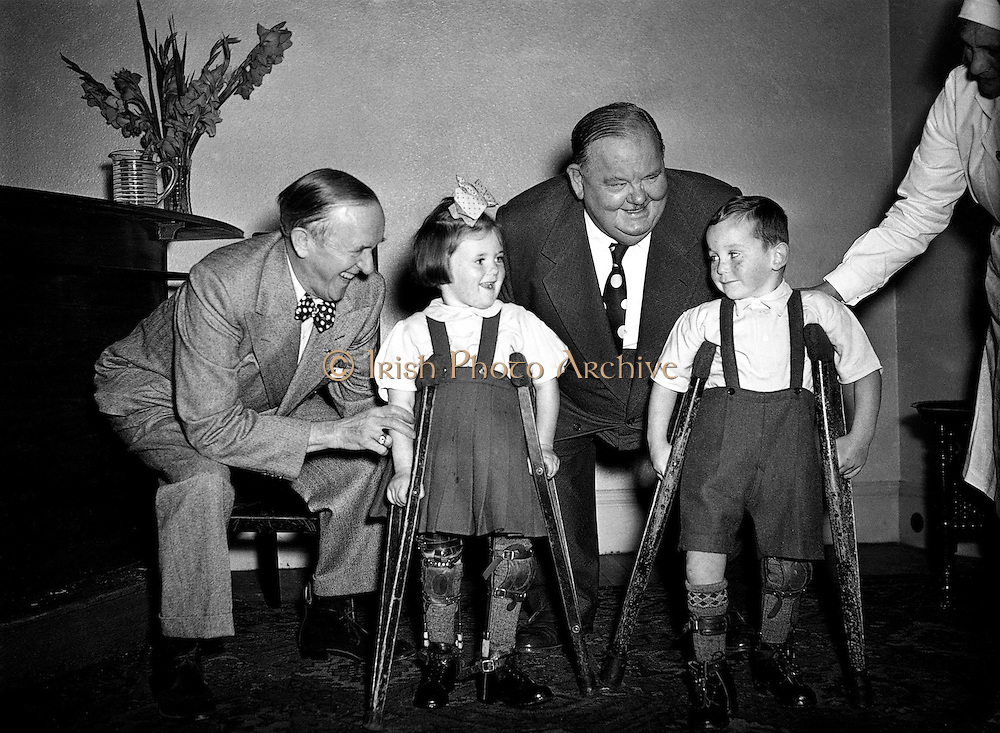 "Laurel and Hardy present cheque on behalf of Premier (DOMAS) to Little Willie Fund.22/09/1953..Laurel and Hardy were one of the most popular and critically acclaimed comedy double acts of the early Classical Hollywood era of American cinema. Composed of thin Englishman Stan Laurel (1890-1965) and heavy American Oliver Hardy (1892-1957) they became well known during the late 1920s to the mid-1940s for their slapstick comedy, with Laurel playing the clumsy and childlike friend of the pompous Hardy.[1] They made over 100 films together, initially two-reelers (short films) before expanding into feature length films in the 1930s. Their films include Sons of the Desert (1933), the Academy Award winning short film The Music Box (1932), Babes in Toyland (1934), and Way Out West (1937). Hardy's catchphrase ""Well, here's another nice mess you've gotten me into!"" is still widely recognized."