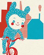 Child in costume balances on bike outside houses