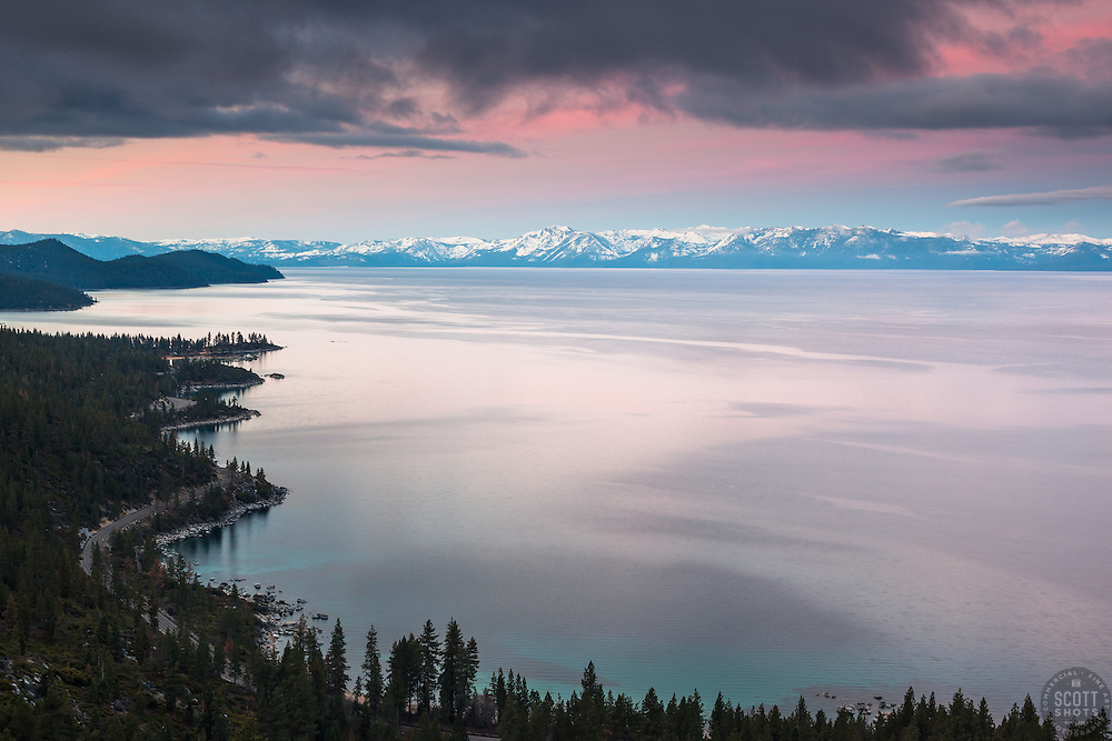 """""""Sunrise at Lake Tahoe 17"""" - Photograph of a wavy Lake Tahoe East Shore shoreline shot at sunrise. Memorial Point and Sand Harbor can be seen."""