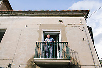 ACCIAROLI, ITALY - 14 SEPTEMBER 2018: Giuseppe Vassallo (95) is seen here on his balcony in Acciaroli, a small fishing village in the municipality of Pollica, Italy, on September 14th 2018. Giuseppe Vassallo was an Italian Navy official during WWII. At age 86, 8 years ago, Mr Vassallo had multiple sex affairs to overcome his depression following his wife's death. He was a testimonial of the Acciaroli's mediterranean diet and lifestyle during Expo 2015, the Universal Exposition hostel in Milan last year.<br /> <br /> To understand how people can live longer throughout the world, researchers at University of California, San Diego School of Medicine have teamed up with colleagues at University of Rome La Sapienza to study a group of 300 citizens, all over 100 years old, living in Acciaroli (Pollica), a remote Italian village nestled between the ocean and mountains in Cilento, southern Italy.<br /> <br /> About 1-in-60 of the area's inhabitants are older than 90, according to the researchers. Such a concentration rivals that of other so-called blue zones, like Sardinia and Okinawa, which have unusually large percentages of very old people. In the 2010 census, about 1-in-163 Americans were 90 or older.