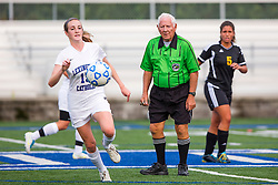 Soccer Referee Aubrey Cashman, center watches play around midfield during soccer matches between Lexington Catholic and Henry Clay, Tuesday, Aug. 13, 2013 at Lexington Catholic Soccer/Football Stadium in Lexington. Photo by Jonathan Palmer