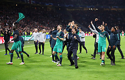 Tottenham Hotspur manager Mauricio Pochettino (centre) and team-mates celebrate after the final whistle during the UEFA Champions League Semi Final, second leg match at Johan Cruijff ArenA, Amsterdam.