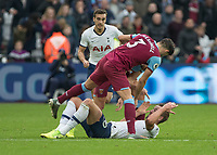 Football - 2019 / 2020 Premier League - West Ham United vs. Tottenham Hotspur<br /> <br /> Aaron Cresswell (West Ham United) and Robert Snodgrass (West Ham United) stand over Harry Kane (Tottenham FC)  accusingly after he goes down at the London Stadium<br /> <br /> COLORSPORT/DANIEL BEARHAM