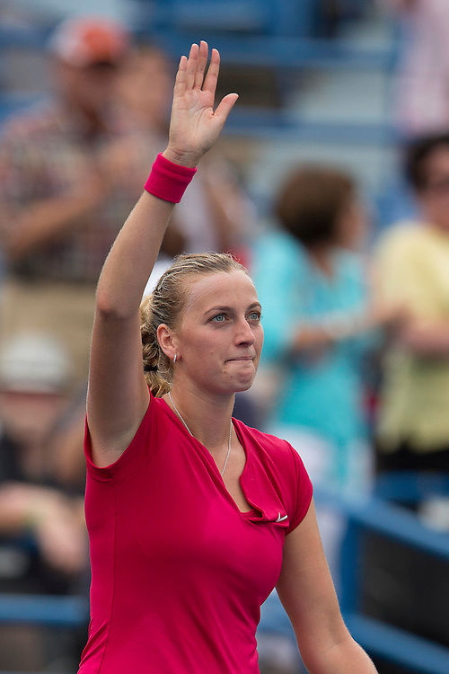August 23, 2014, New Haven, CT:<br /> Petra Kvitova waves to the crowd after winning the singles final against Magdalena Rybarikova on day nine of the 2014 Connecticut Open at the Yale University Tennis Center in New Haven, Connecticut Saturday, August 23, 2014.<br /> (Photo by Billie Weiss/Connecticut Open)