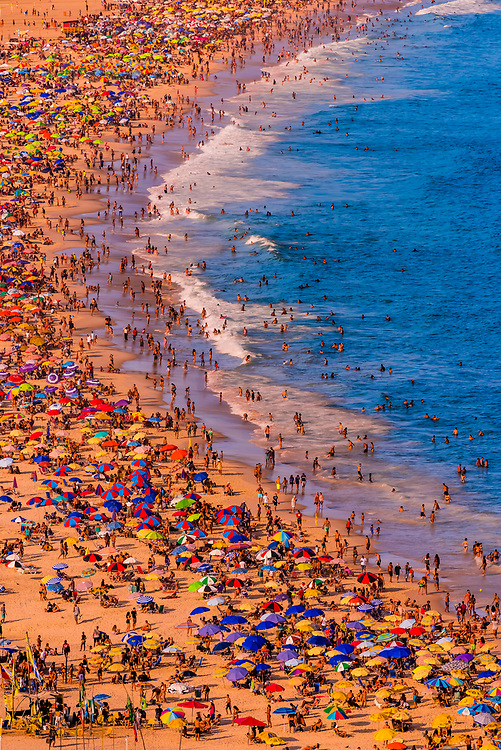 High angle view of Copacabana Beach, crowded with sunbathers during Carnaval, Rio de Janeiro, Brazil.