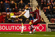 Aberdeen FC Defender Mark Reynolds makes a vital clearance during the Scottish Cup fourth round match between Heart of Midlothian and Aberdeen at Tynecastle Stadium, Gorgie, Scotland on 9 January 2016. Photo by Craig McAllister.