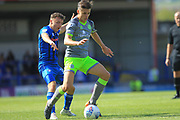 Ollie Rathbone challenges George Dobson during the EFL Sky Bet League 1 match between Rochdale and Walsall at Spotland, Rochdale, England on 25 August 2018.