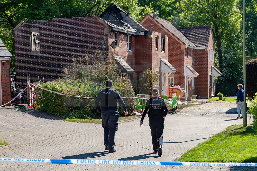 © Licensed to London News Pictures. 06/05/2020. Woolton Hill, UK. Two police officers from the Hampshire Constabulary walk towards two houses gutted by fire. A fire has destroyed two houses on Woolton Lodge Gardens, Woolton Hill in Hampshire. The fire started approximately 20:10 BST on Tuesday 05/05/2020. Photo credit: Peter Manning/LNP