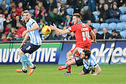 Oldham Athletic striker Jake Cassidy and Coventry City midfielder Jim O'Brien battle during the Sky Bet League 1 match between Coventry City and Oldham Athletic at the Ricoh Arena, Coventry, England on 19 December 2015. Photo by Alan Franklin.