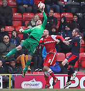 Picture by David Horn/Focus Images Ltd +44 7545 970036.23/02/2013.Jamie Jones and Scott Cuthbert of Leyton Orient prevent Mark Connolly of Crawley Town scoring during the npower League 1 match at the Matchroom Stadium, London.
