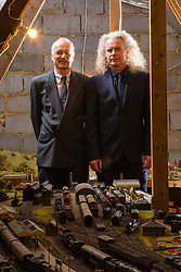 Brothers Simon, 53 and Paul Hurst, 58 have some of their late father's ashes carried around his extensive model railway in the loft of his home. PICTURED: Paul, left and Simon in the lot with their their father's model railway. Leeds, Kent, March 15 2018.