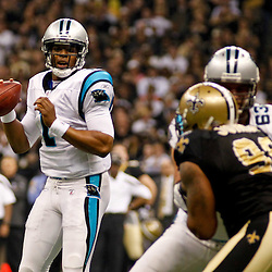 January 1, 2012; New Orleans, LA, USA; Carolina Panthers quarterback Cam Newton (1) passes against the New Orleans Saints during the first quarter of a game at the Mercedes-Benz Superdome. Mandatory Credit: Derick E. Hingle-US PRESSWIRE