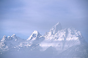 A cold fog shrouds the peaks of the Teton Mountains in Grand teton National Park, Jackson Hole, Wyoming.