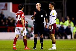 Referee Mike Dean speaks to Joao Carvalho of Nottingham Forest and Jack Grealish of Aston Villa  - Mandatory by-line: Robbie Stephenson/JMP - 13/03/2019 - FOOTBALL - The City Ground - Nottingham, England - Nottingham Forest v Aston Villa - Sky Bet Championship