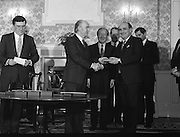 New Fianna Fáil Administration Sworn In.  (R52)..1987..10.03.1987..03.10.1987..10th March 1987..After their win in the recent general election the new Fianna Fáil government,under the leadershio of Charles Haughey, was sworn in and given their seals of offce at a ceremony in Áras an Uachtaráin today. The government received their seals from President Patrick Hillery...Photograph shows President Hillery presenting the seal of office to Gerry Collins at the ceremony in the Arás