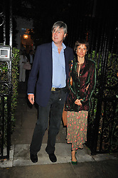 The MARQUESS & MARCHIONESS OF WORCESTER at a Summer party hosted by Lady Annabel Goldsmith at her home Ormeley Lodge, Ham, Surrey on 14th July 2009.
